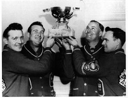 The Gervais team of Hec, Ray Werner, Ron Anton and Wally Ursuliak hoist the Scotch Cup, emblematic of World Curling supremacy, 1961.